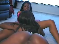 Lewd ebony black lesbian plays with dildo